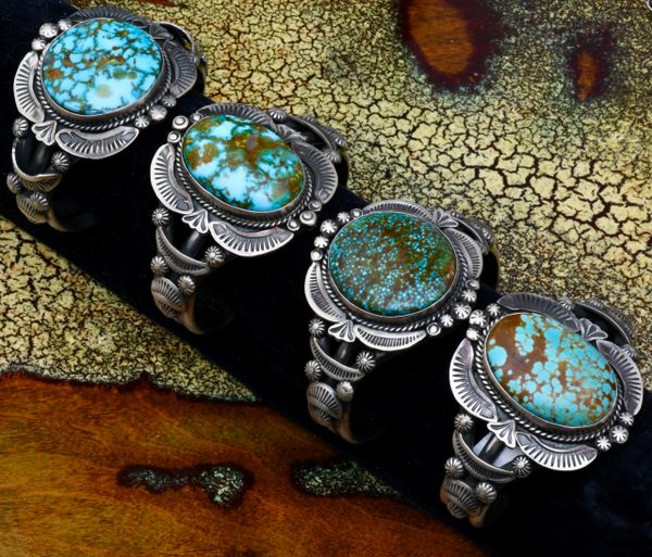 Red-web (water-web) Kingman turquoise Gilbert Tom hand-stamped, small wrist-size Navajo cuff (3rd from right). #1711