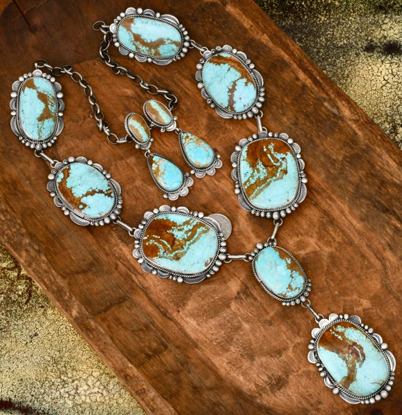 Gilbert Tom Navajo lariat necklace and matching earrings with very large No. 8 Mine turquoise stones. #1738