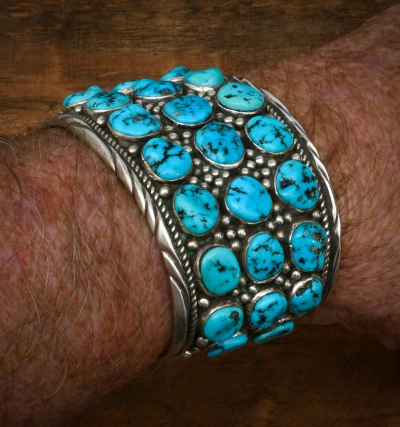 Massive Navajo dead-pawn cuff with 31 Sleeping Beauty turquoise stones. #1741