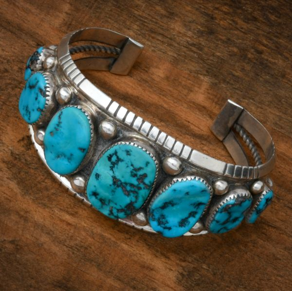Dead-pawn seven-stone Sleeping Beauty turquoise Navajo cuff. #1784