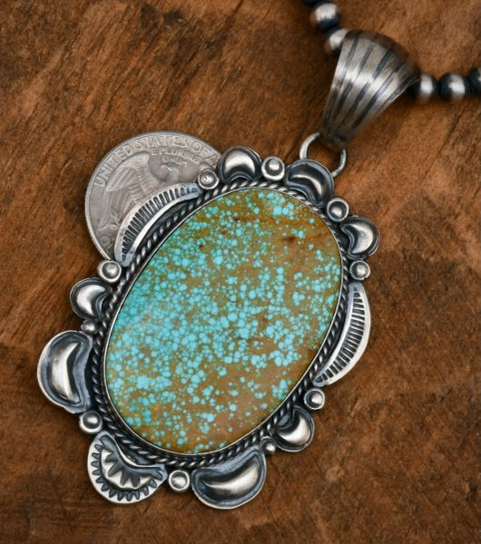 Larger Gilbert Tom' No. 8 Mine turquoise old-style patina pendant—shown with optional 5mm, 24-inch burnished Sterling Navajo 'pearls.' #1799