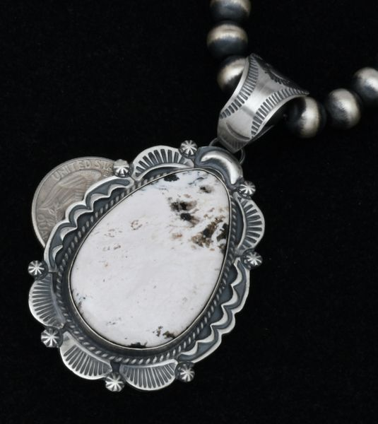 Robert Shakey White Buffalo Navajo pendant in old-style patina. Shown with optional 8mm, 20-inch burnished Sterling Navajo 'pearls.' #1803