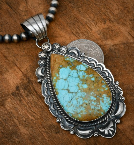 Robert Shakey' large teardrop-shaped old-style hand-stamped and reverse-stamped repousse' pendant with No. 8 Mine turquoise. #1824
