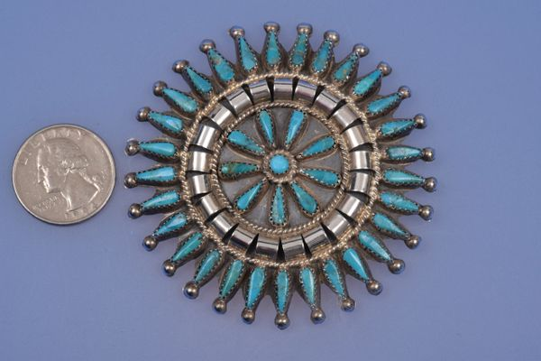 Navajo 39-stone pendant/broach by Tommy Lowe.