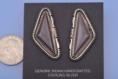 """Dead-pawn Navajo earrings hallmarked """"EK."""""""