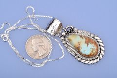 Navajo pendant with rare, pale-shade Royston Nevada turquoise by Augustine Largo