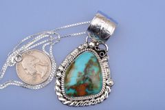 Navajo pendant with dark Royston Nevada turquoise by Augustine Largo.—SOLD!