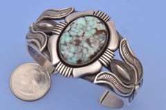 Large heavy silver, satin-finish Dry Creek turquoise cuff.