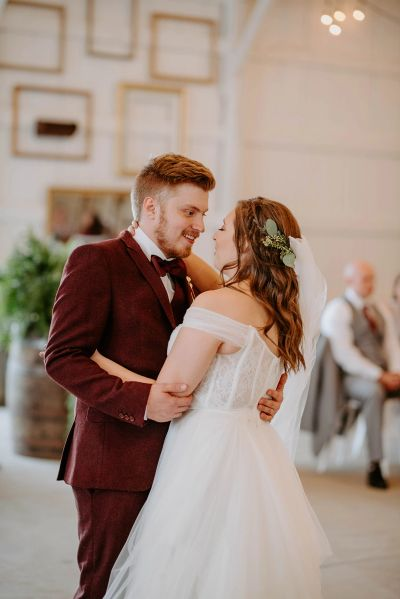 A Bride and Groom's first dance in the all-white modern barn