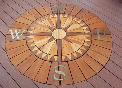 Custom Deck Inlay-Deck Designs of Brentwood builds custom decks, porches, screened additions, gazebos, garages, trellises and backyard bridges. Franklin, Green Hills, Tennessee.