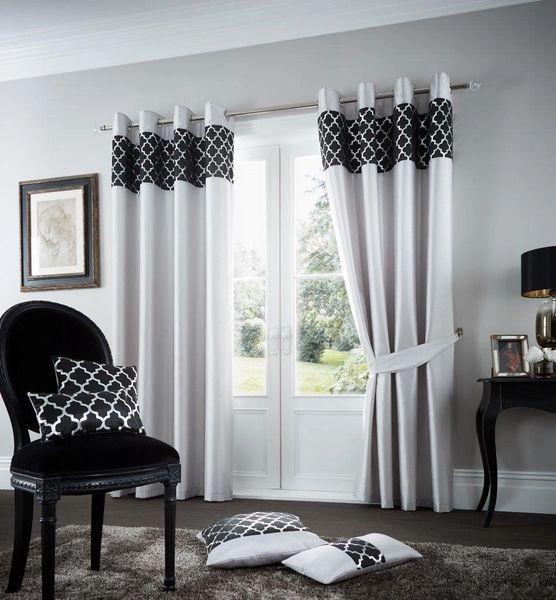 Shiny silver eyelet curtains