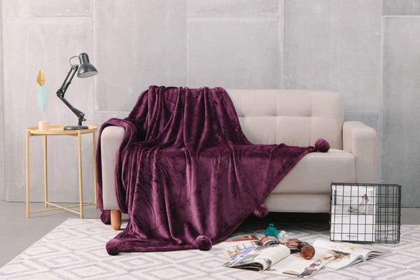 Pom Pom plain aubergine faux fur throw