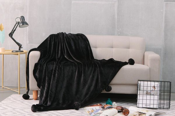 Pom Pom plain black faux fur throw