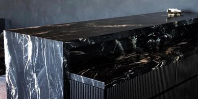 Portoro Black and Gold Quartzite Leather Finish on a bar top with waterfall edge