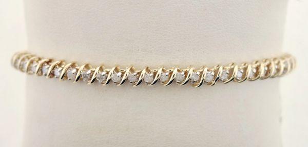 """1.5 ct. t.w. Diamond """"S"""" Shaped Tennis Bracelet in 14k Yellow Gold"""