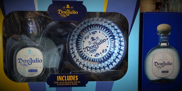 liquor gift box of don julio. includes bottle of don julio and commemorative glasses and dishes