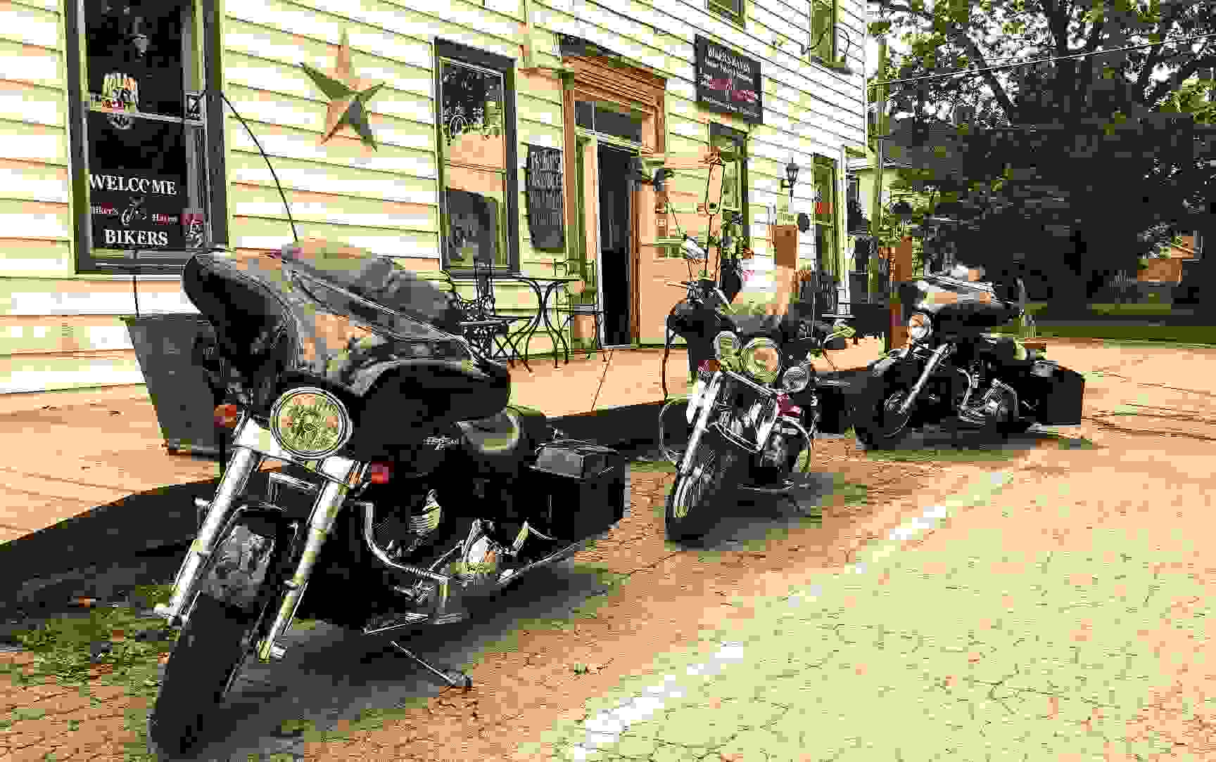 3  motorcycles parked in front of the Haldimand House Marketplace, Caledonia Ontario.