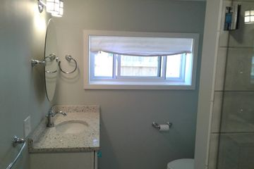Bathroom remodel, masonry tile flooring and tile shower.