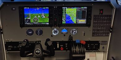 The Piper Seminole Frasca RTD configuration with G1000NXi panel flying over Chicago.