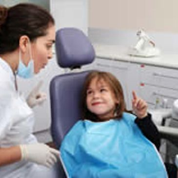 Best children's dentist in Toowoomba, Queensland: Dr Jane Vlismas with a happy little customer.