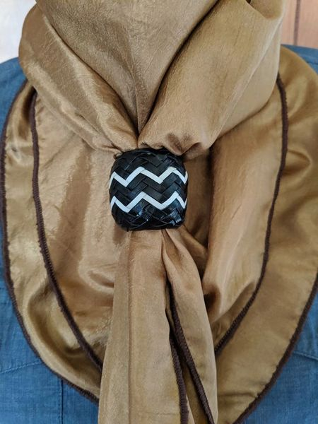 Black and white rawhide scarf slide with metal core