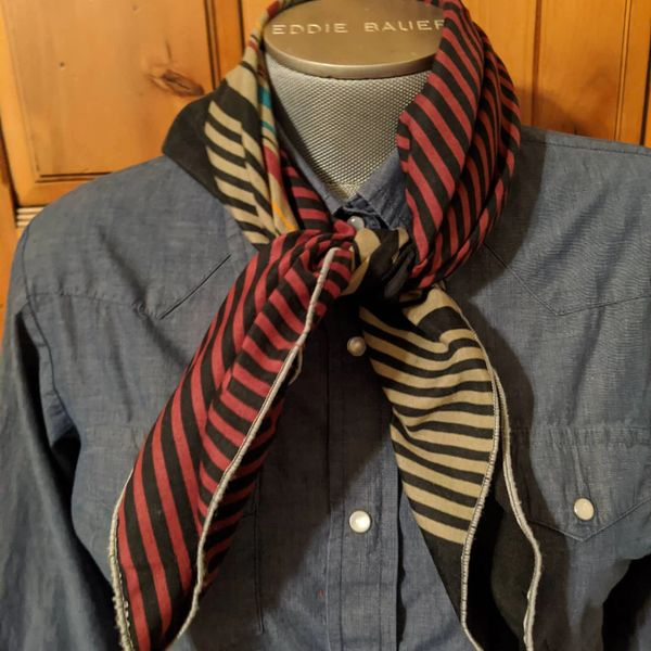 27x27 cotton black, tan, teal, gold, maroon line print wild rag