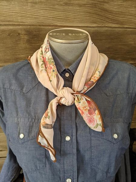 26x26 tan peach back ground with steer head with roses and southwestern print wild rag is light weight and sheer