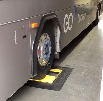 Prototype DOS in bus service center; the low-profile system requires no fixturing to the floor, but