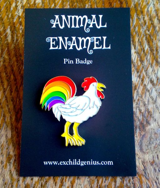 Proud Rainbow Cock! Enamel Pin Badge of a Colourful Feathered Cockerel designed by Ex Child Genius