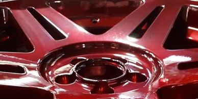 Red painted alloy wheel