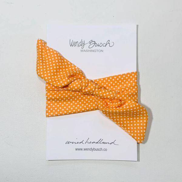 Bright orange with white dots