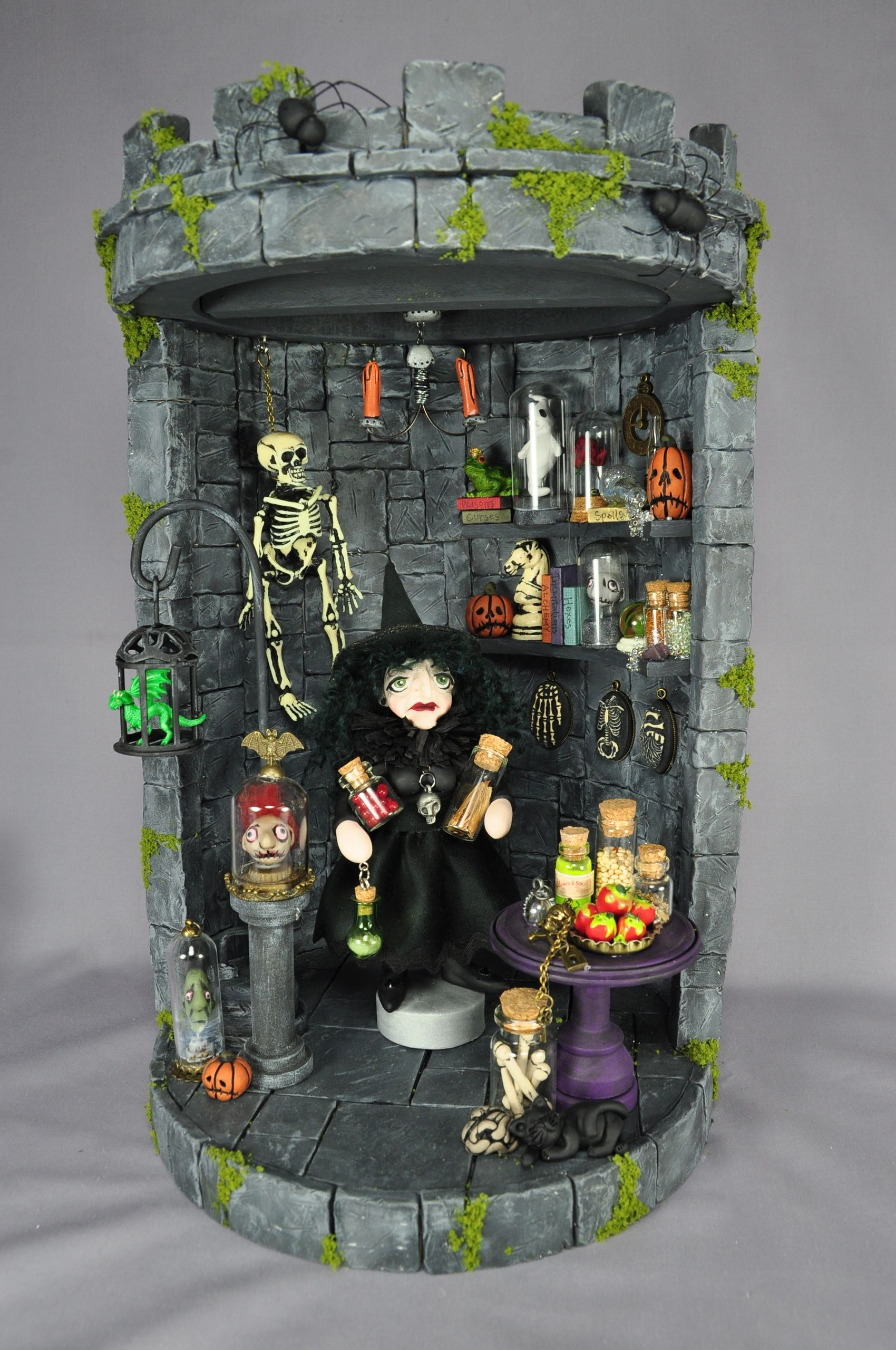 Intricately detailed mixed-media castle shadow box vignette with wicked witch polymer clay art doll