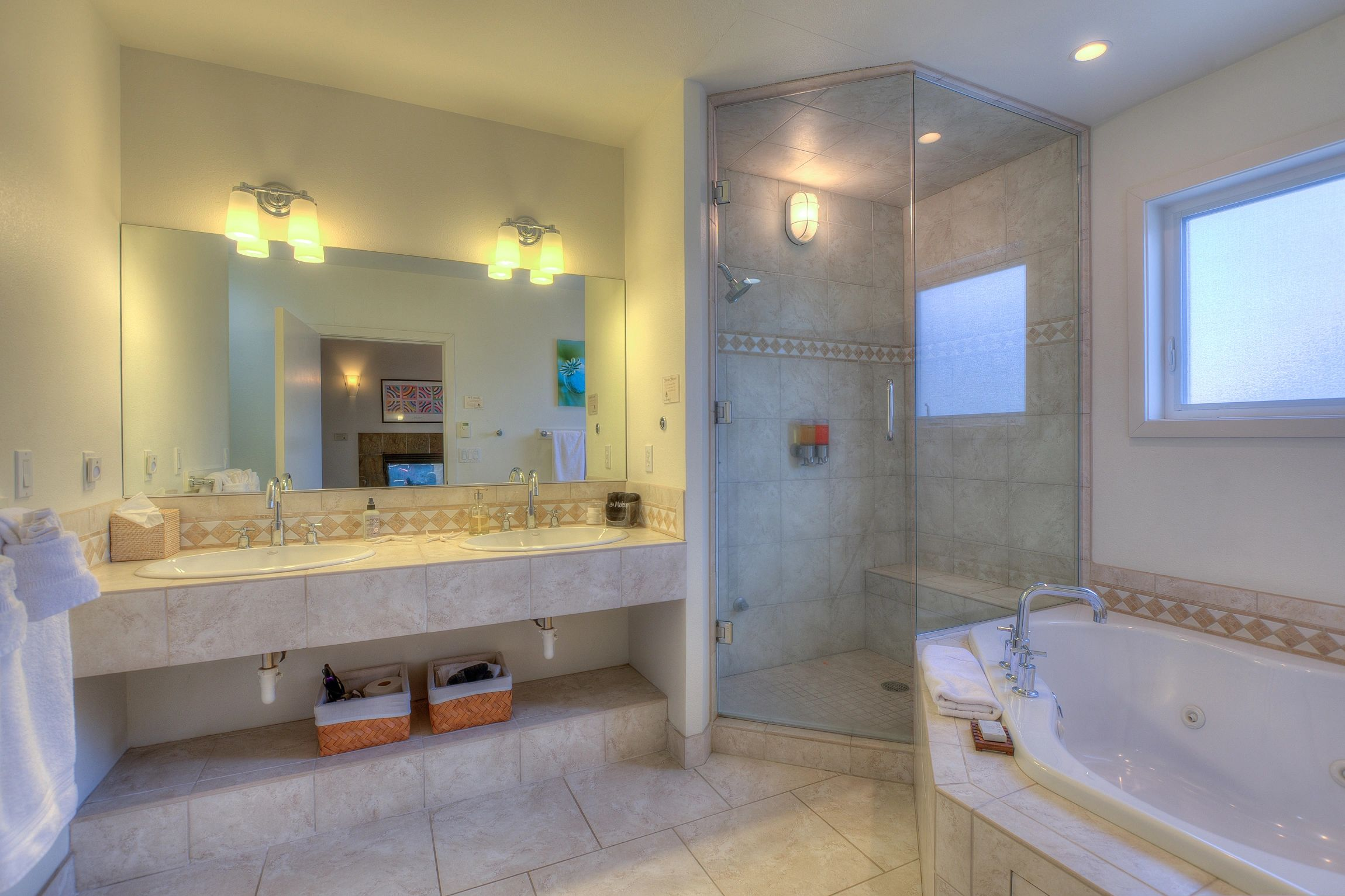 two-person corner jetted tub. Jacuzzi. Double sink. Luxury steam shower. Large master bathroom.