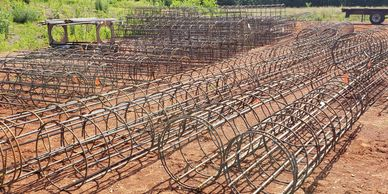 CBS  fabricates pre-assembled rebar cages for light pole bases, substations , & sign foundations