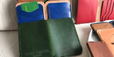 Men's Leather Wallets made with 4 card slots and 2 slots for bills. Made in Raleigh, NC.