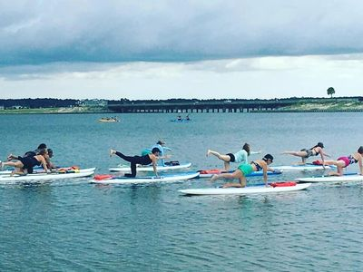 SUP Yoga classes and Private SUP Lessons offered by Navarre Beach Yoga Studio.