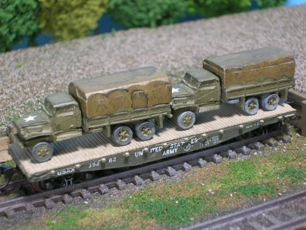 (2) Chevrolet 2 1/2 Ton Cargo Trucks on US Army Transportation Corp Flat Car
