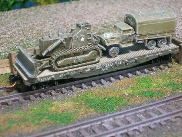 Combat Dozer and 2 1/2 Ton Maintenance Van on US Army Transportation Corp Flat Car