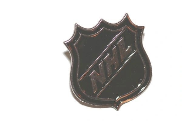 NHL LOGO METAL LAPEL PIN BADGE .. NEW AND IN A PACKAGE