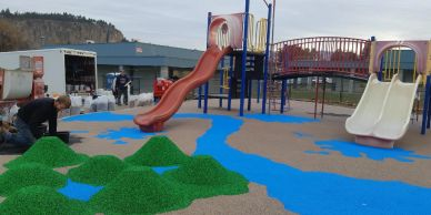 Glenmore Elementary had an existing playground that had pea-gravel for the safety surfacing. The pro