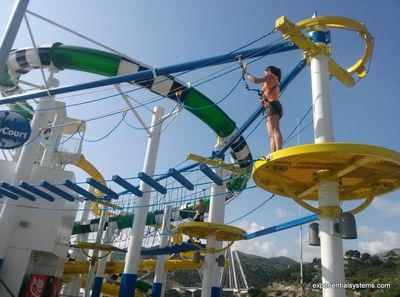 Cruise ship passenger on aerial adventure park.