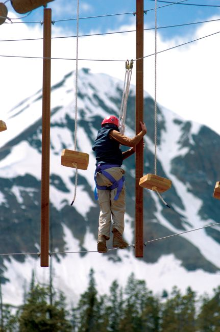 Participant on ski resort high ropes course