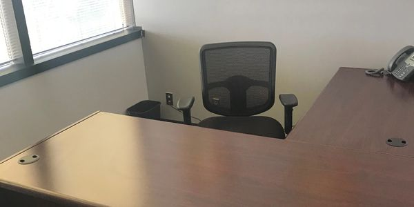 shared desks for rent in business center, reception services included with office space, small office