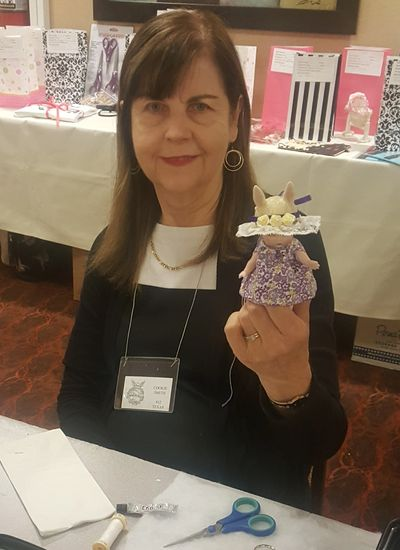 Cookie Smith showing off her finished project. Bunny Love Workshop taught by Sylvia Greer.
