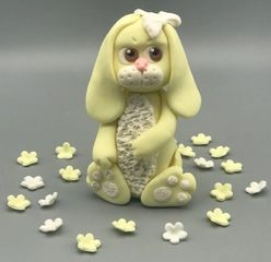Handmade Rabbit made of edible modelling paste. Available in pink, blue or yellow.  Approx 10cms. (4