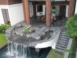 Pool waterfall water feature in Palm Beach Florida A Florida Waterfall company