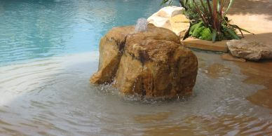 Pool Water feature boulder fountain pool waterfall