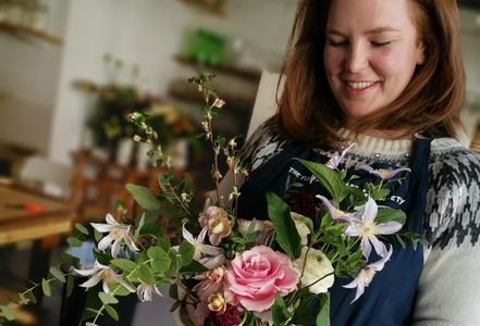 Laura Blakeley, co-founder of Horseshoe Farm Flowers, holding bouquet of flowers