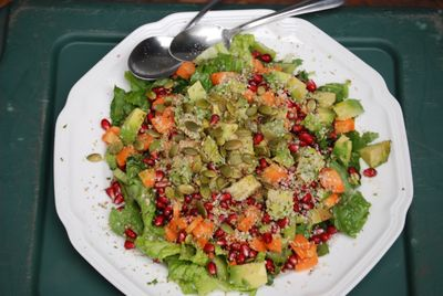Pate of lettuce salad with pumpkin and pomegranate seeds.