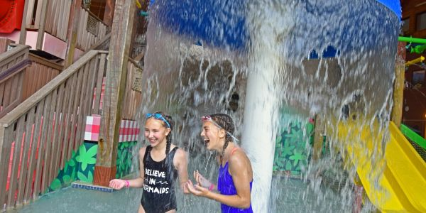 Girls laughing in the indoor waterpark